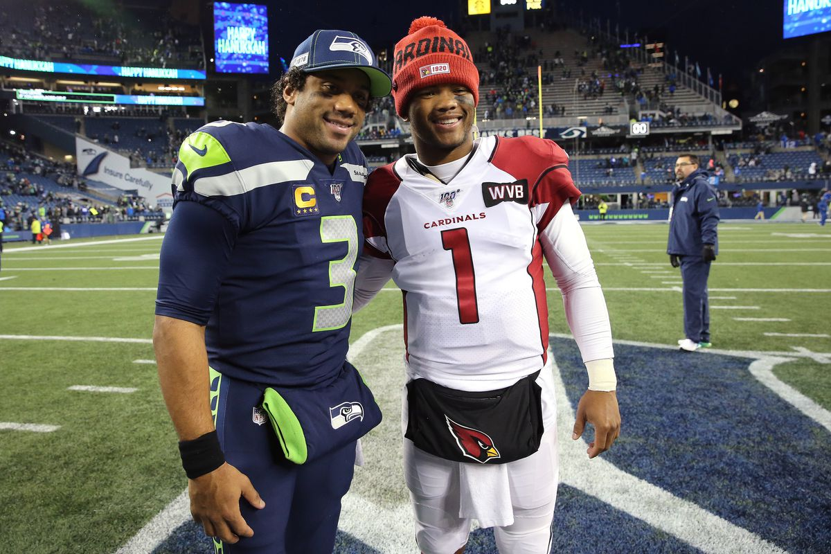 Russell Wilson #3 of the Seattle Seahawks and Kyler Murray #1 of the Arizona Cardinals pose for a photo after the Arizona Cardinals defeated the Seattle Seahawks 27-13 during their game at CenturyLink Field on December 22, 2019 in Seattle, Washington.