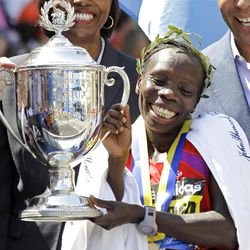 Women's winner Sharon Cherop of Kenya smiles as she holds the trophy at the finish area of the 2012 Boston Marathon in Boston, Monday, April 16, 2012. (AP Photo/Elise Amendola)