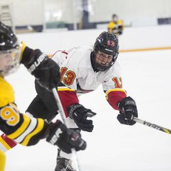 Calgary Inferno forward Kelty Apperson looks for the puck during a game between the Boston Blades and Calgary Inferno in Winthrop, MA on Oct. 22.