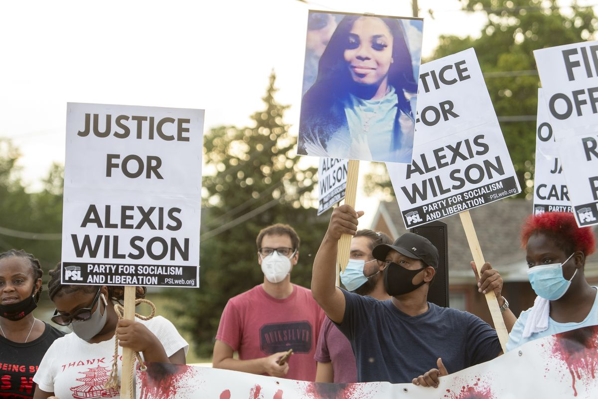 A group of about a dozen people protested outside a a mandatory homeowners meeting with the mayor over a police-involved shooting that left Alexis Wilson dead last month, Thursday, Aug. 26, 2021, in Dolton, Ill.