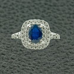 """<a href=""""http://www.craigerdrake.com/index.htm"""">Craiger Drake</a> 1 carat oval sapphire ring surrounded by double halo diamonds, ~$3K"""