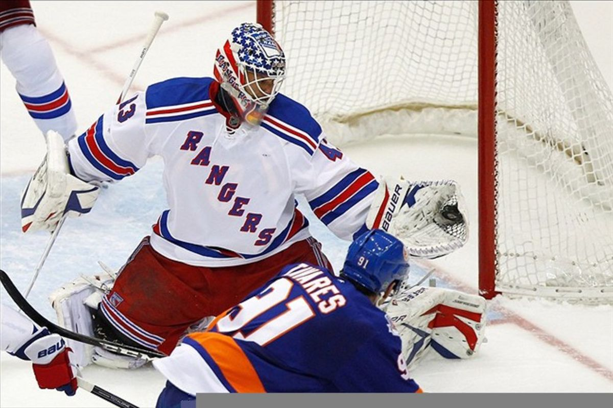 Feb. 24, 2012; Uniondale, NY, USA; New York Rangers goalie Martin Biron (43) makes a save in front of New York Islanders center John Tavares (91) during the game at Nassau Veterans Memorial Coliseum. Mandatory Credit: Debby Wong-US PRESSWIRE