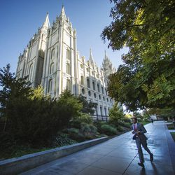 A man hurries toward the Conference Center for the Sunday morning session of the 183rd Semiannual General Conference for The Church of Jesus Christ of Latter-day Saints Sunday, Oct. 6, 2013.