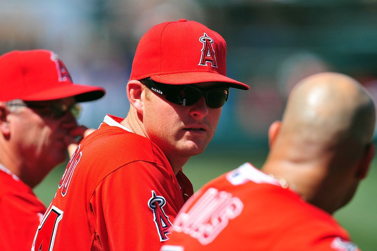 May 15, 2012; Anaheim, CA, USA; Los Angeles Angels third baseman Mark Trumbo (44) watches game action in the seventh inning against the Chicago White Sox at Angel Stadium. Mandatory Credit: Gary A. Vasquez-US PRESSWIRE