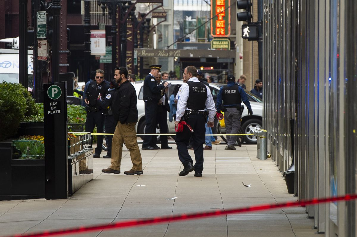 Chicago police investigate a person shot Saturday afternoon near Adams and Wabash. | Tyler LaRiviere/Sun-Times