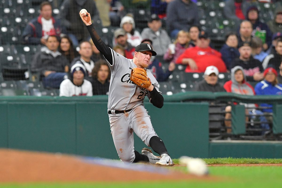 Third baseman Andrew Vaughn #25 of the Chicago White Sox throws to first on a ground ball hit by Ernie Clement #28 of the Cleveland Indians at first during the fifth inning of game two of a double header at Progressive Field on September 23, 2021 in Cleveland, Ohio.
