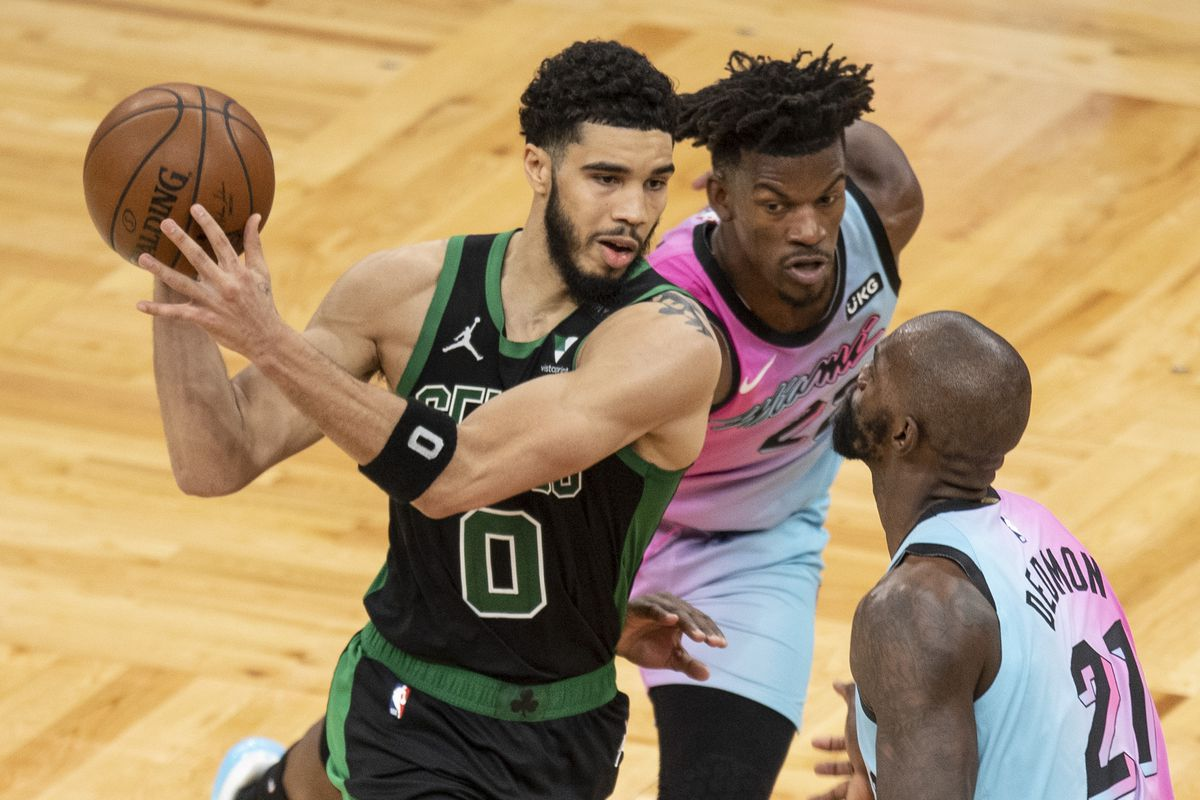 Jayson Tatum of the Boston Celtics drives to the basket while guarded by Jimmy Butler of the Miami Heat during the second half at TD Garden on May 09, 2021 in Boston, Massachusetts.