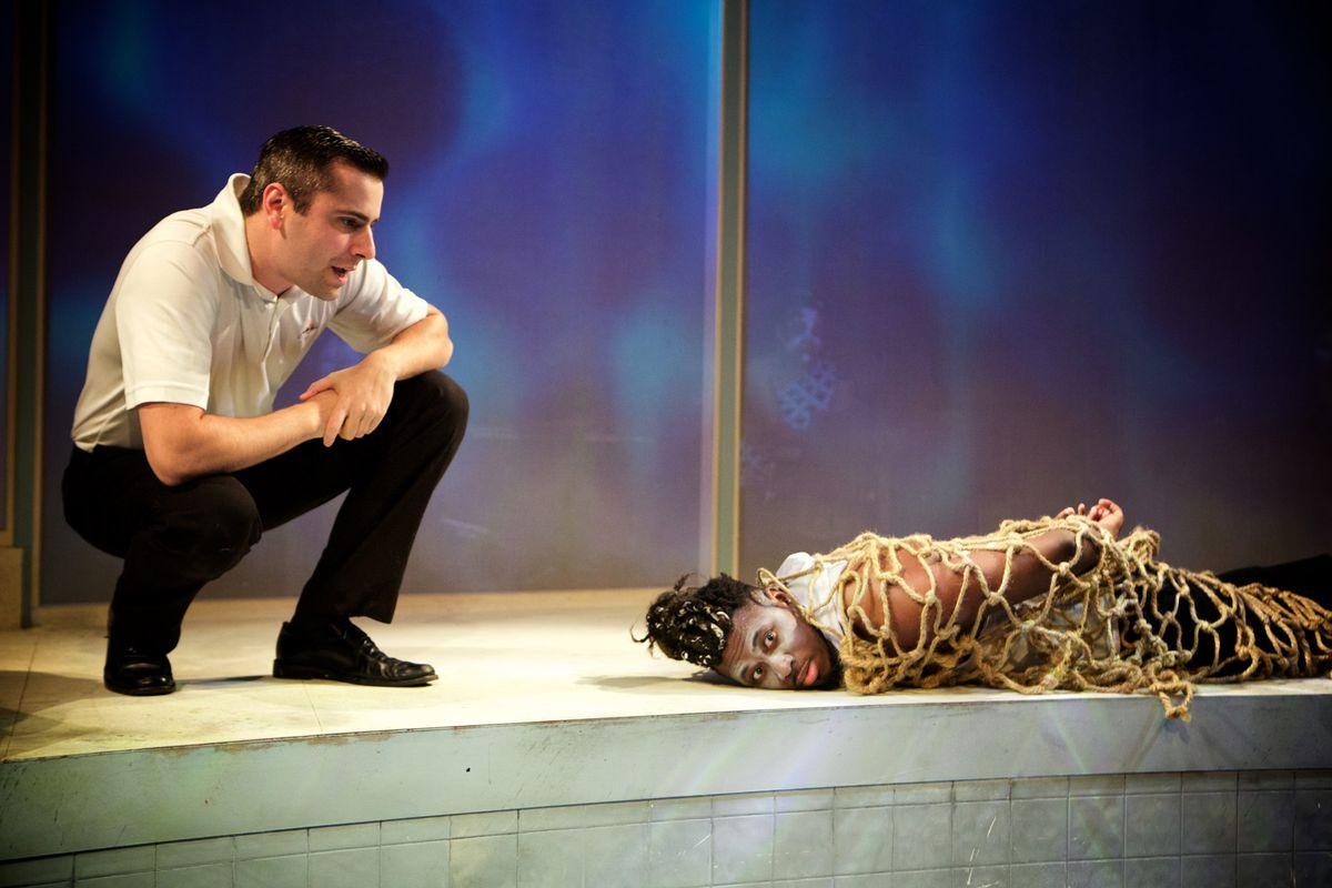 "Matt Fletcher (left) and Gregory Geffrard star in Sideshow Theatre's world premiere of ""Tilikum."" | Jonathan L. Green"