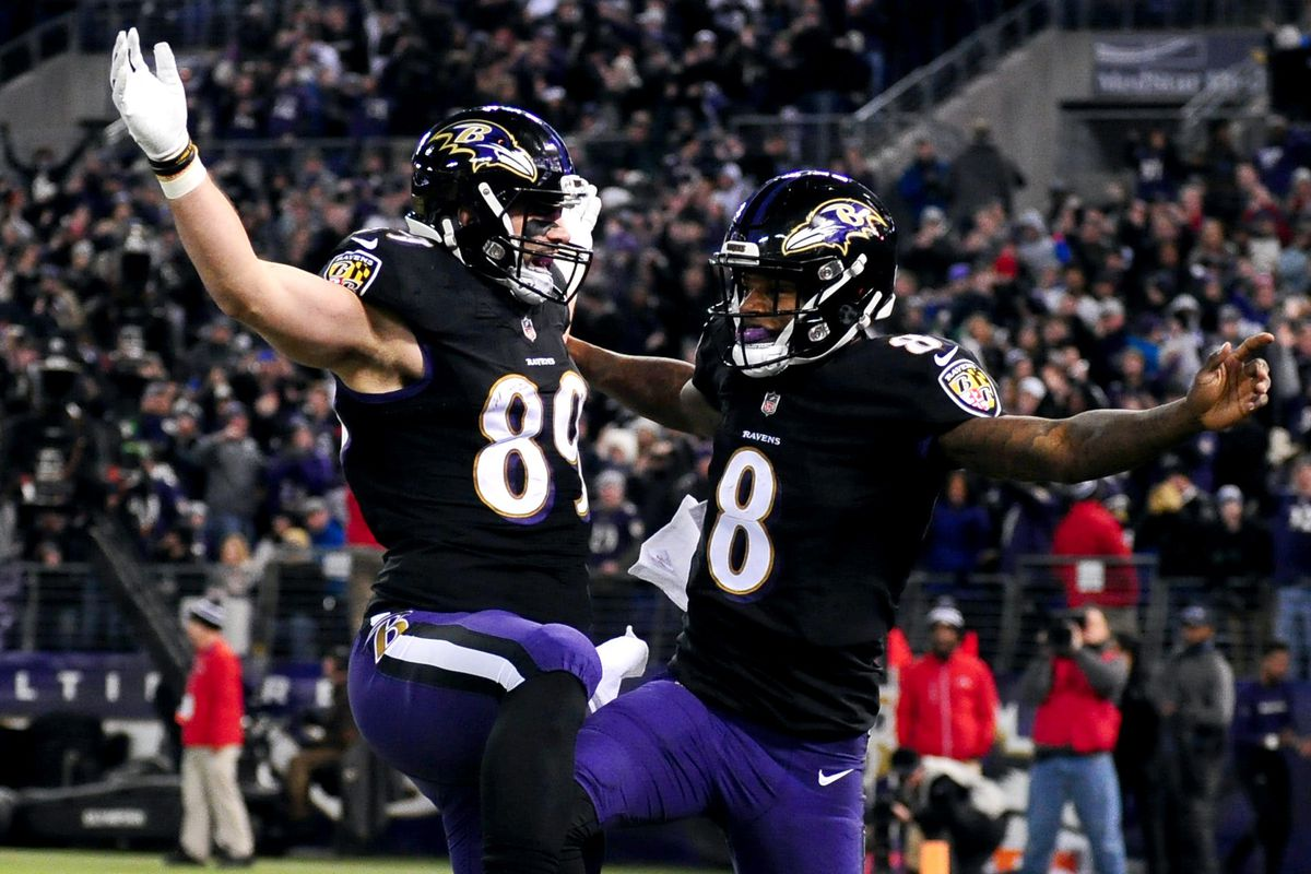 Baltimore Ravens quarterback Lamar Jackson celebrates with tight end Mark Andrews after scoring a touchdown in the second quarter against the Cleveland Browns at M&T Bank Stadium.