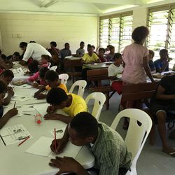 Teenagers in Papua New Guinea who had dropped out of school work with tutors provided by The Church of Jesus Christ of Latter-day Saints in a pilot program launched last month by the Church Education System's Global Education Initiative. The pilot program is one of three underway in island nations.