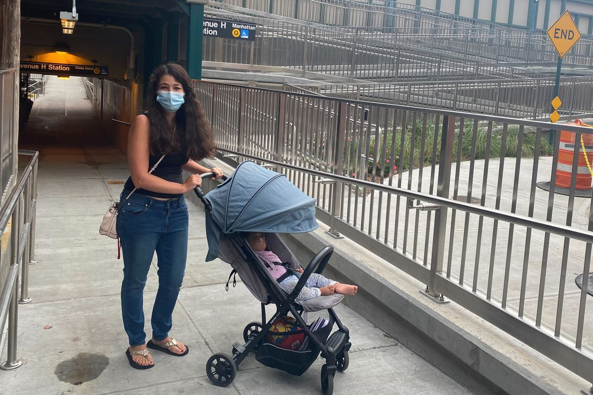 Miyya Algoti pushes a stroller on the new ramp at the Q Train station at Avenue H in Midwood, Brooklyn.