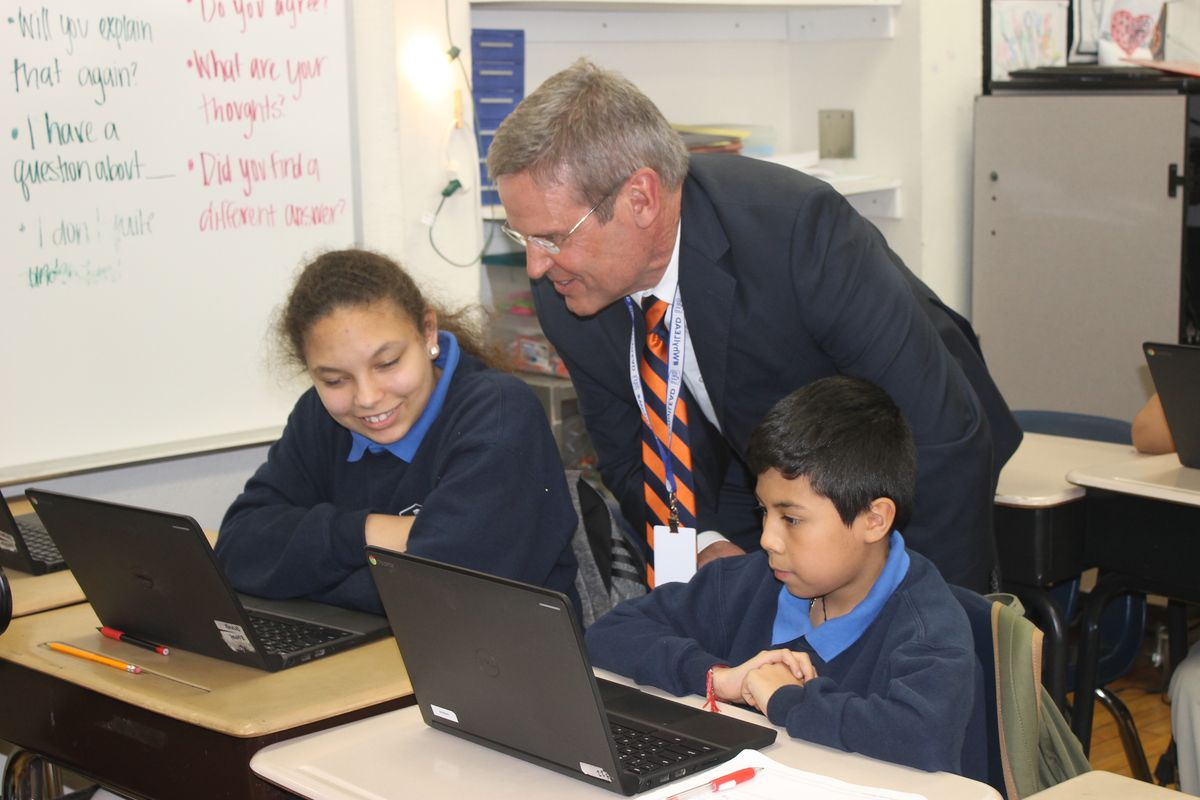 Gov. Bill Lee talks with students at Cameron LEAD, a Nashville charter school that he visited on April 1. Tennessee has struggled to transition to digital testing under its new TNReady assessment.
