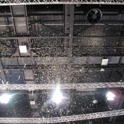 Confetti rained. It was like silver tears from the roof.