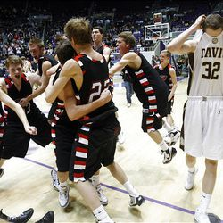 Davis' #32 Riley Watts (right) walks off the floor as Alta players celebrate their win 46-32 in the 5A boys Basketball championship game in Ogden.