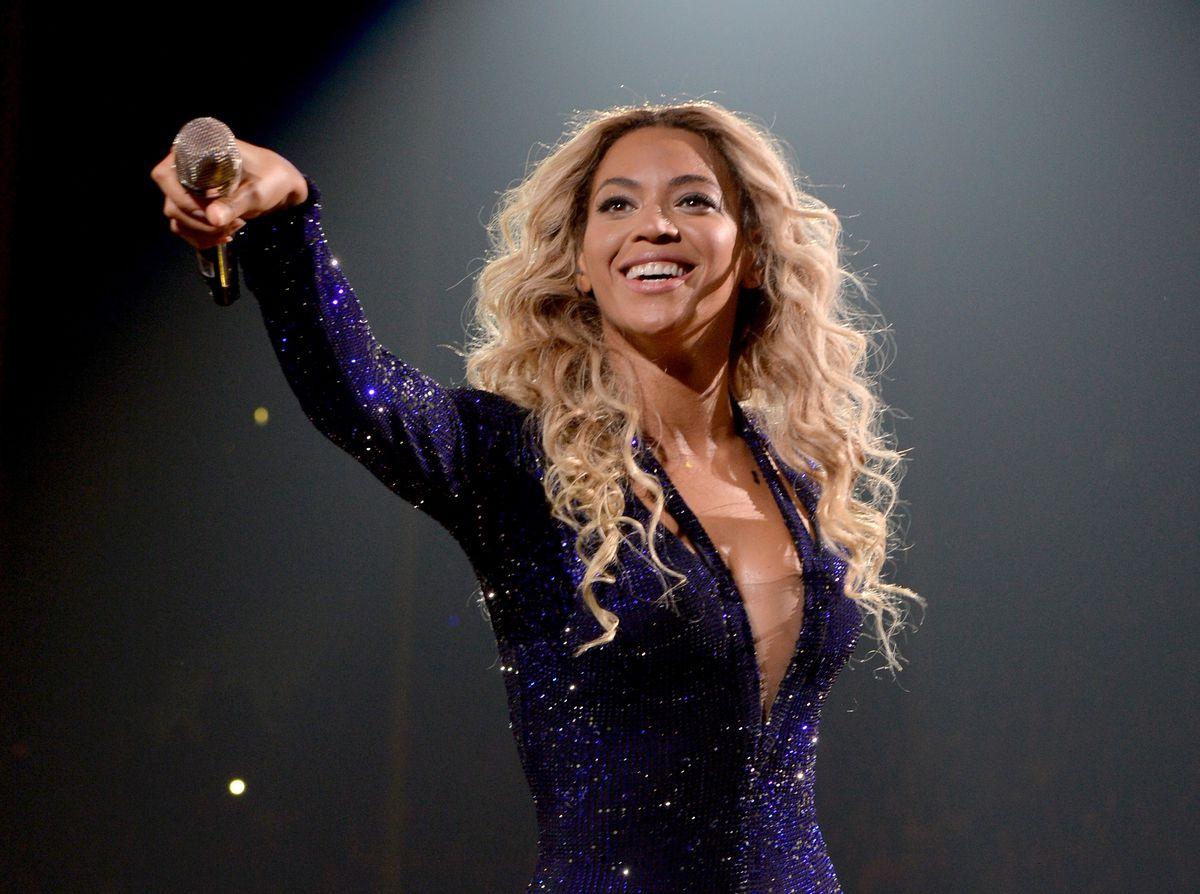 Beyoncé prepares to drop the mic while performing.