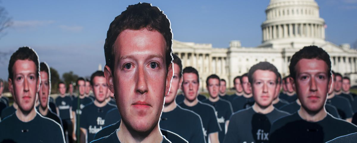 Dozens of life-sized cardboard figures of Facebook CEO Mark Zuckerberg on the U.S. Capitol lawn