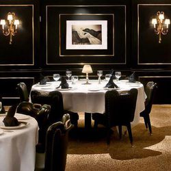 One could argue that pretty much all of DC's steakhouses are iconic in their own way, but the Prime Rib stands out. Yes, there are black and gold lacquered panels and leopard carpeting that helps the restaurant achieve a pretty dark backroom feel. [Photo: