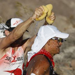 A crew member squeezes wet sponges over Oswaldo Lopez of Madera, California during the AdventurCORPS Badwater 135