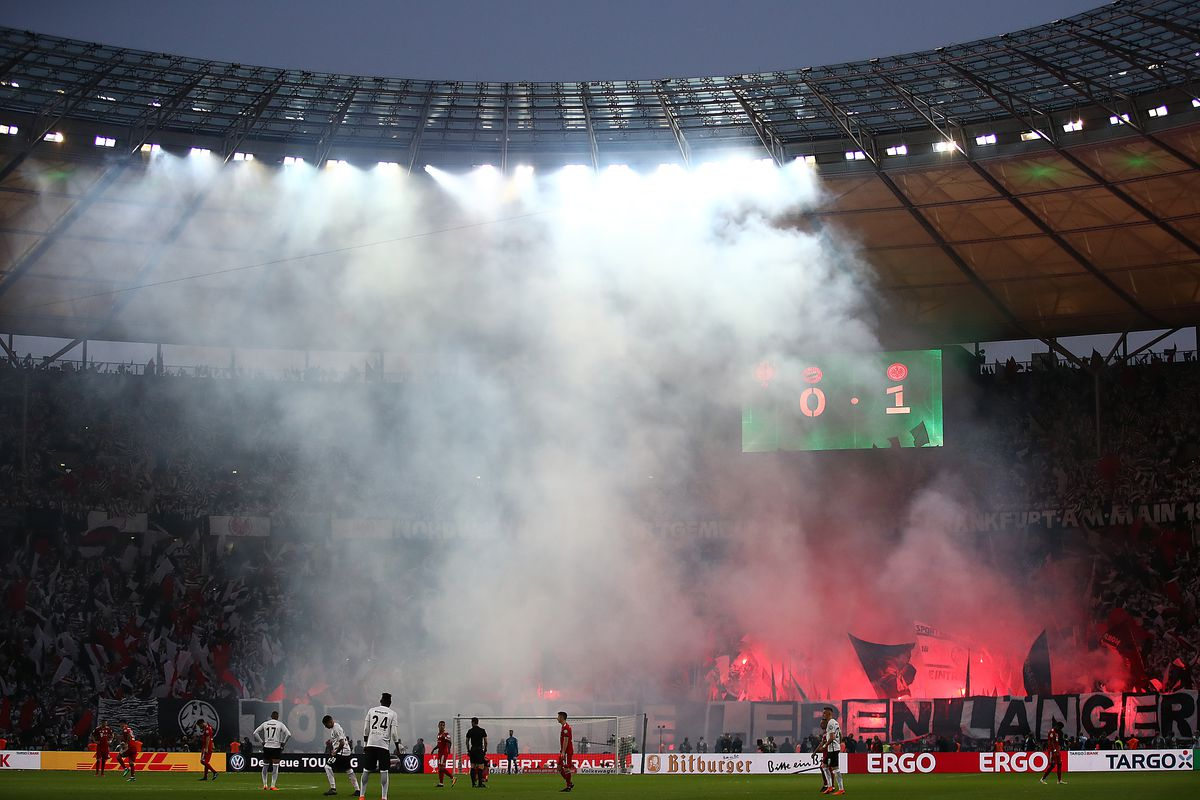 Bayern Muenchen v Eintracht Frankfurt - DFB Cup Final BERLIN, GERMANY - MAY 19: Supporters of Frankfurt light flares as smoke is seen during the DFB Cup final between Bayern Muenchen and Eintracht Frankfurt at Olympiastadion on May 19, 2018 in Berlin, Germany.