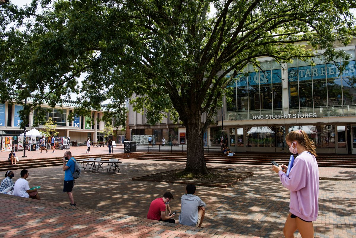 Students walk past the UNC Student Stores on the Chapel Hill campus of the University of North Carolina.