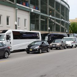 3:27 p.m. Coach buses lined up along Addison -