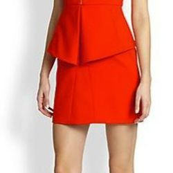 "Tibi Zip-Front Structured Peplum Dress, $395, <a href=""http://www.saksfifthavenue.com/main/ProductDetail.jsp?PRODUCT%3C%3Eprd_id=845524446685148&R=885551446923&P_name=Tibi&sid=14589B6AD884&Ntt=cayenne&N=0&bmUID=km9IC8T"">Saks Fifth Avenue</a>"