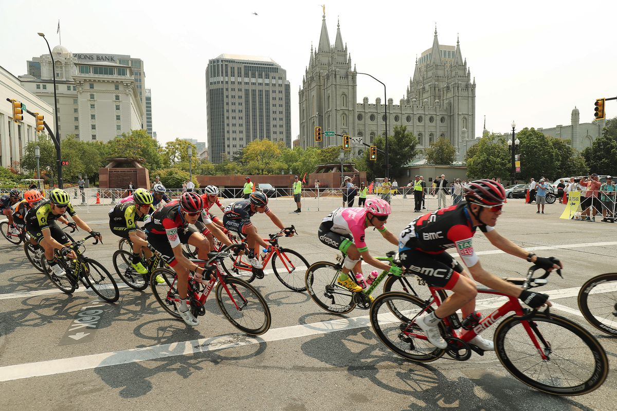 Competitors race past the LDS Temple in Salt Lake City during Stage 4 of the Tour of Utah on Friday, Aug. 10, 2018.