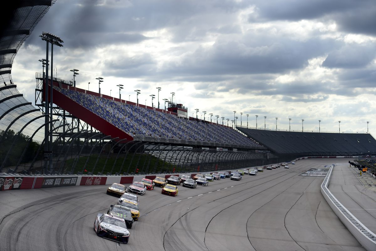 Drivers race in front of empty stands during NASCAR's return at Darlington.