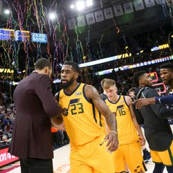 Utah Jazz center Rudy Gobert (27) and forward Royce O'Neale (23) embrace as the Jazz celebrate their 106-77 win over the Denver Nuggets at Vivint Smart Home Arena in Salt Lake City on Tuesday, Nov. 28, 2017.