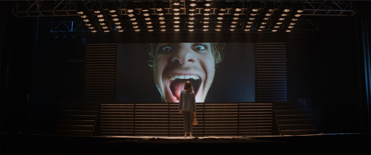 Maya Hawk stares at a giant screen of Andrew Garfield with his mouth agape in Mainstream