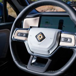 <em>The R1T has a relatively normal steering wheel.</em>