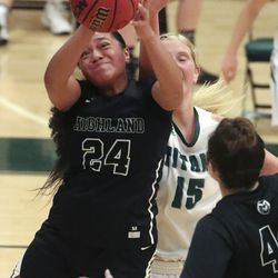 Highland's Sosefina Langi, left, rips a rebound away from Olympus forward Alyssa Blanck during a game at Olympus High School in Holladay on Tuesday, Jan. 5, 2021.
