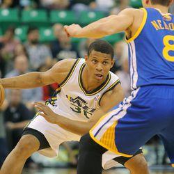Utah's Scott Machado looks to get around Warriors' Nemanja Nedovic as the Utah Jazz and the Golden State Warriors play Tuesday, Oct. 8, 2013 in preseason action at Energy Solutions arena in Salt Lake City.