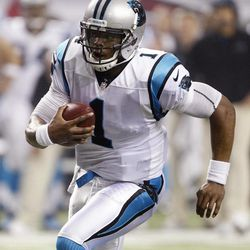 Carolina Panthers quarterback Cam Newton runs for a score during the second half of an NFL football game against the Atlanta Falcons on Sunday, Sept. 30, 2012, in Atlanta.
