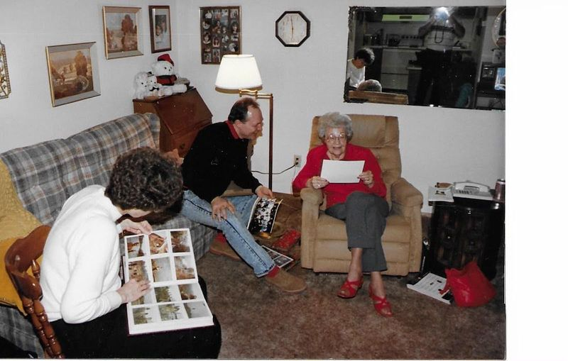 Jim Zwit (center) going over photos from Vietnam with relatives of Bob Hein, an Army friend killed in the Vietnam War: Hein's mother Catherine Hein-Markley (right) and Hein's sister Toni Doucet.