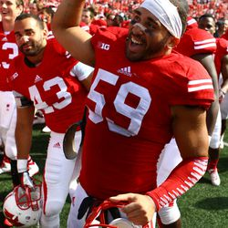 Linebacker Marcus Trotter (and brother Michael) celebrate the Badgers win over South Florida