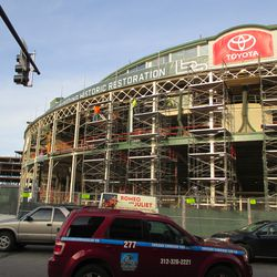 Sun 12/20: sunlit view, main facade, the old bottom support of the marquee still survives (at left of scaffolds) -