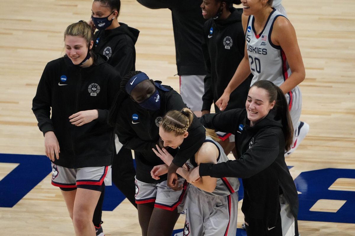 Connecticut Huskies guard Paige Bueckers (5) celebrates with her teammates after defeating the Baylor Lady Bears in the Elite Eight of the 2021 Women's NCAA Tournament at Alamodome.