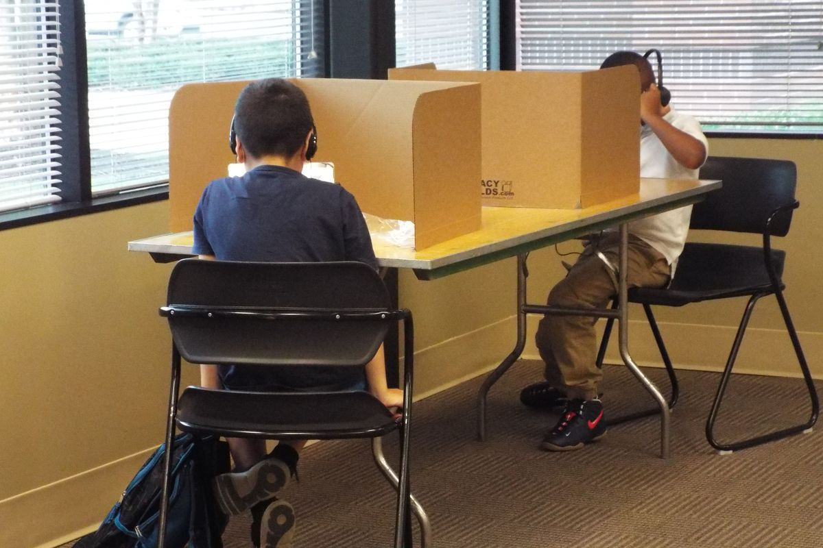 Shelby County Schools students log in remotely from the YMCA's virtual learning center in Cordova on the first day of school.