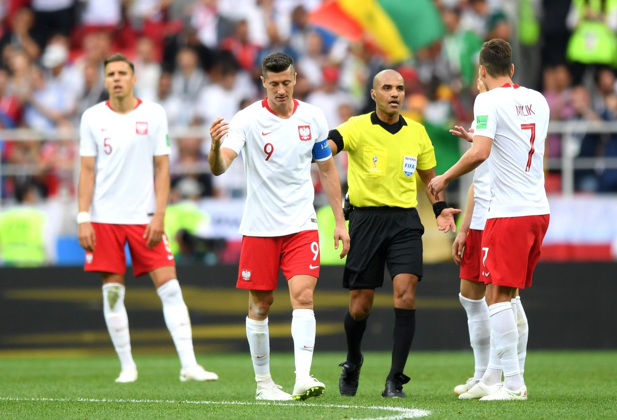 Poland v Senegal: Group H - 2018 FIFA World Cup Russia MOSCOW, RUSSIA - JUNE 19: Referee Nawaf Shukralla talks to Robert Lewandowski of Poland during the 2018 FIFA World Cup Russia group H match between Poland and Senegal at Spartak Stadium on June 19, 2018 in Moscow, Russia.