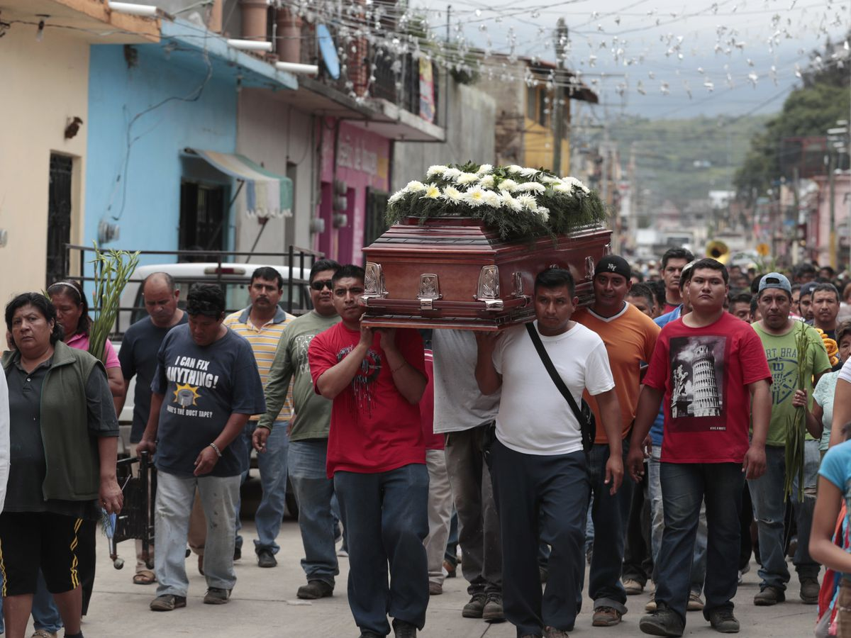 Residents on Wednesday carry the casket of a woman who died in Tuesday's earthquake, in Tlayacapan, Morelos state, Mexico. | Eduardo Verdugo/Associated Press