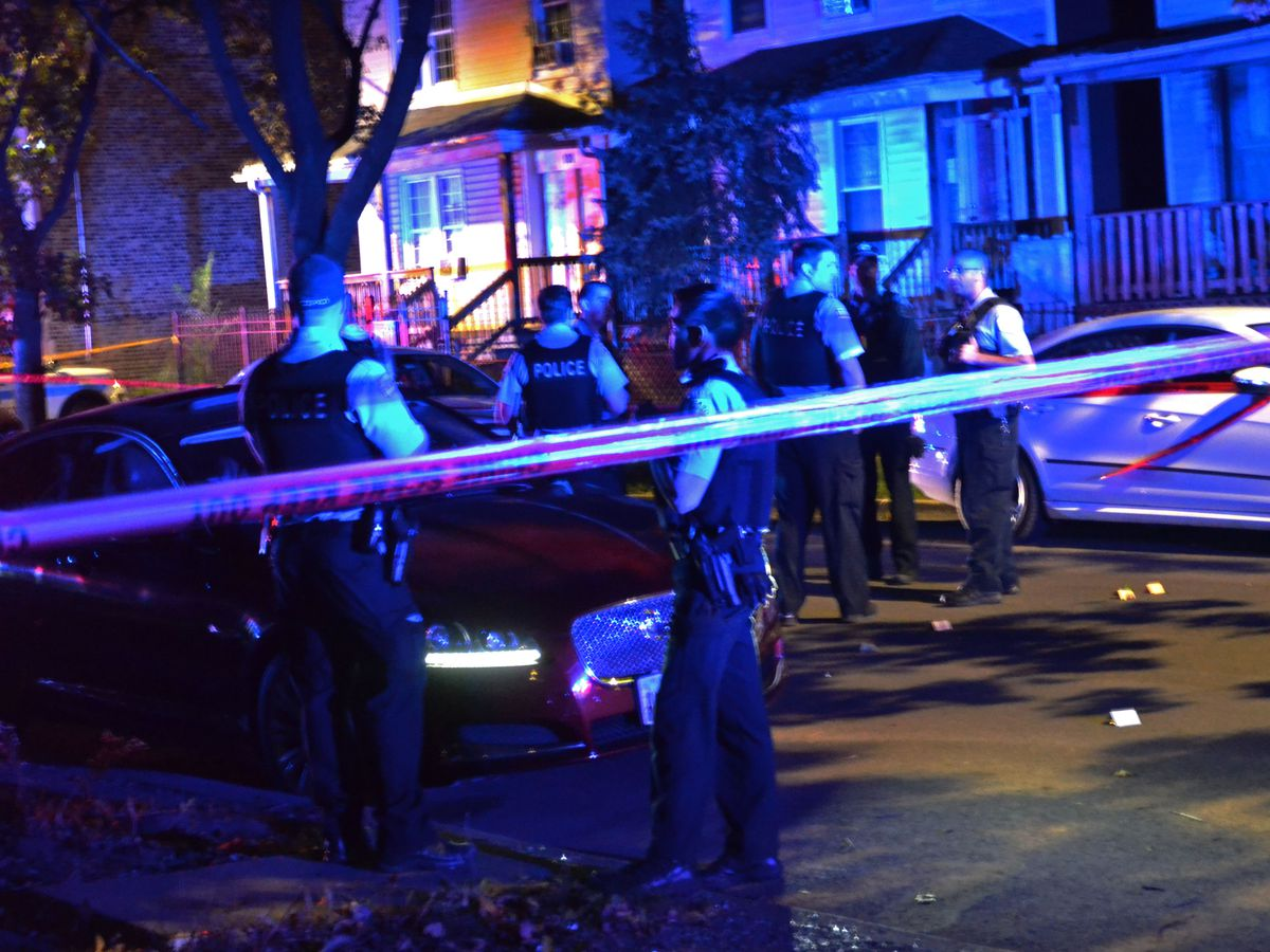 Police investigate a shooting about 3:30 a.m. Saturday, September 22, 2018 in the 100 block of North Karlov Avenue in Chicago. | Justin Jackson/ Sun-Times