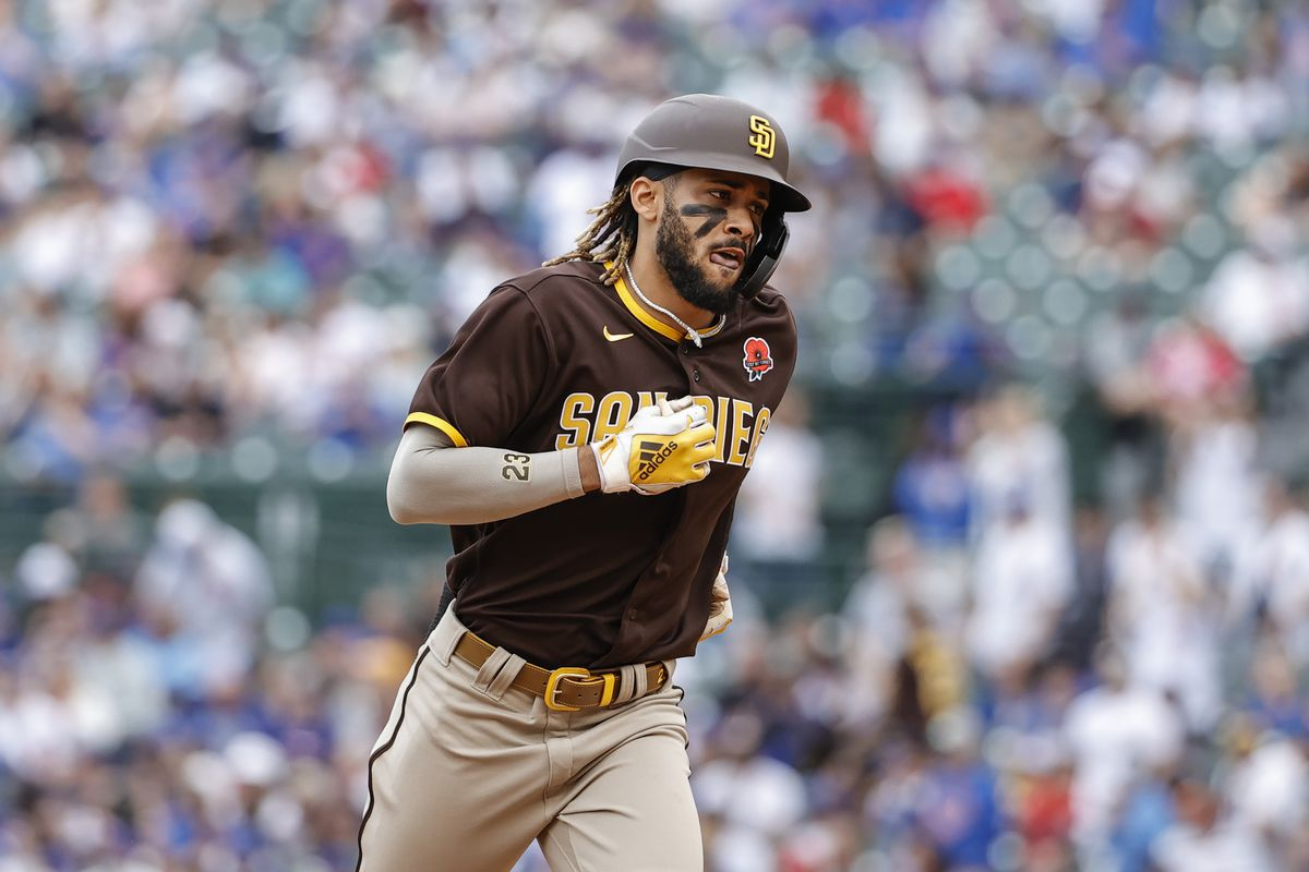 San Diego Padres shortstop Fernando Tatis Jr. (23) rounds the bases after hitting a solo home run against the Chicago Cubs during the sixth inning at Wrigley Field.