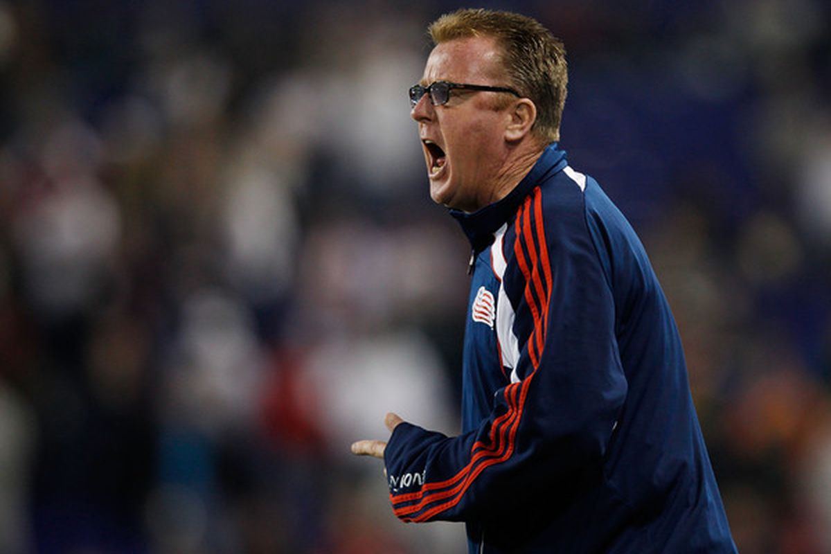 HARRISON NJ - OCTOBER 21:  Head Coach Steve Nicol of New England Revolution directs from the bench against the New York Red Bulls on October 21 2010 at Red Bull Arena in Harrison New Jersey.  (Photo by Mike Stobe/Getty Images for New York Red Bulls)