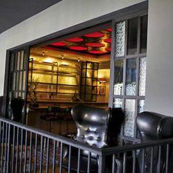 Upstairs bar overlooking gray room.