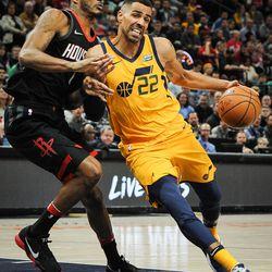 Utah Jazz forward Thabo Sefolosha (22) tires to wrestle his way around Houston Rockets forward Trevor Ariza (1) as the Utah Jazz host the Houston Rockets at Vivint Smart Home Arena Salt Lake on Thursday, Dec. 7, 2017.