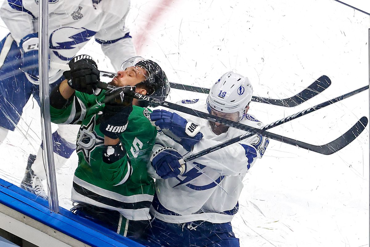Barclay Goodrow #19 of the Tampa Bay Lightning checks Andrej Sekera #5 of the Dallas Stars into the boards during the first period in Game Three of the 2020 NHL Stanley Cup Final at Rogers Place on September 23, 2020 in Edmonton, Alberta, Canada.