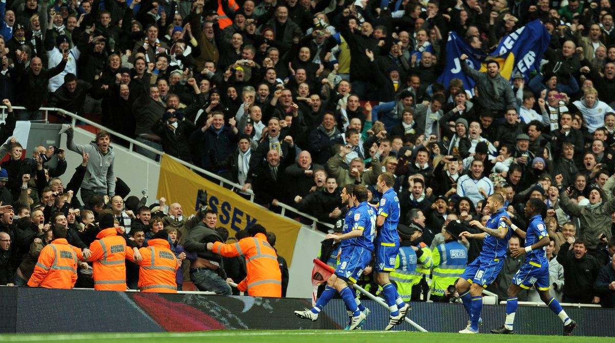 Leeds United's players run to their supporters to celebrate.