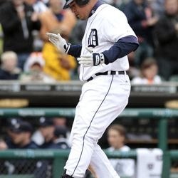 Detroit Tigers' Miguel Cabrera crosses home plate after hitting a solo home run against the Minnesota Twins in the fourth inning of a baseball game Saturday, Sept. 22, 2012, in Detroit.
