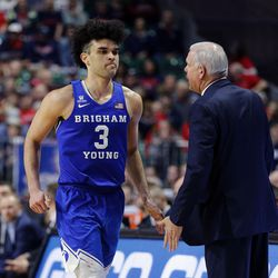 BYU guard Elijah Bryant goes by Brigham Young Cougars head coach Dave Rose during game against Gonzaga on Tuesday, March 6, 2018. Bryant opted to forego his senior season to instead pursue a professional career.